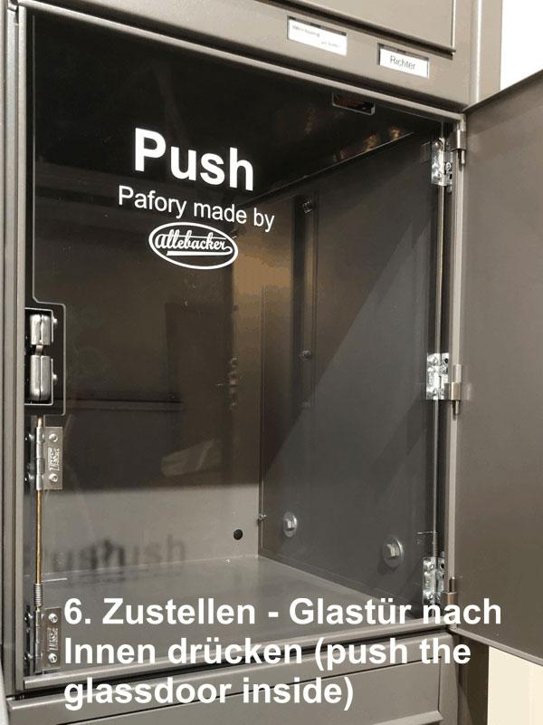 """Parcel-Box Paketbriefkasten Paketkasten - Briefkasten Kombination """"pafory"""" Schritt 6: Zustellen - Glastür nach innen drücken"""